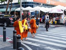 Young Monks crossing the road. 21th September, 2017. Bangkok, T stock image