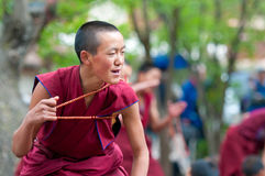 Young monks debating in the Tashilunpo monastery. SHIGATSE - SEPTEMBER 17: young monks debating in the Tashilunpo monastery area on September 17, 2010 in Royalty Free Stock Image