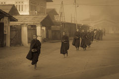 Young monks get food offerings in early morning Stock Image