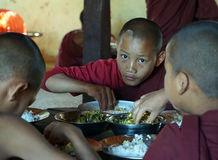 Young monks. KALAW, MYANMAR - CIRCA APRIL 2017 Young monks near the table Royalty Free Stock Photography