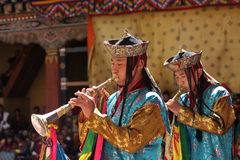 Young monks at Paro Tsechu festival, i. Young monks making music a Paro Tsechu festival, in Paro, Bhutan Stock Images