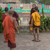 Young monks are playing ball Royalty Free Stock Photo