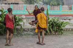 Young monks are playing ball Royalty Free Stock Photos