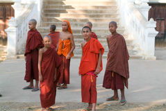 Young monks posing in front of Maing Thauk forest monastery Royalty Free Stock Photography
