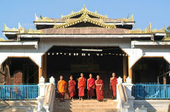 Young monks posing in front of Maing Thauk forest monastery Stock Image