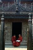 Young monks reading a book at Shwenandaw Monastery. Royalty Free Stock Photos