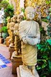 ํYoung monks stones walk to received food. Royalty Free Stock Image