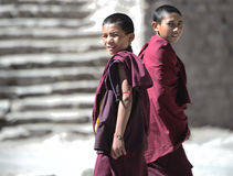 Young Monks. Two Young Monks at Famous Hemis Monastery in Ladakh region of India. Nearly every Ladakhi family offers one of their sons to the monasteries to be stock images