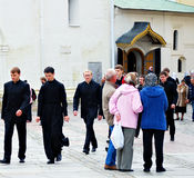 Young monks walk in Trinity Sergius Lavra Stock Photography