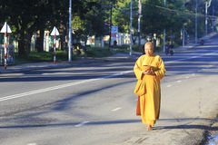 Young monks are walking morning alms in Dalat Royalty Free Stock Image