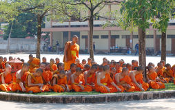 Young monks wearing orange robes Stock Photo