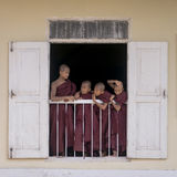 Young monks in window Royalty Free Stock Photo