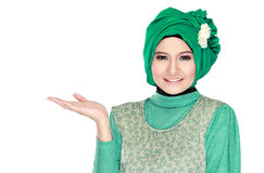 Young moslem woman presenting Stock Images