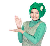 Young moslem woman presenting Royalty Free Stock Photography