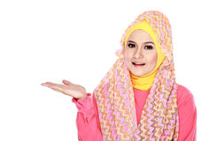 Young moslem woman presenting Stock Photos