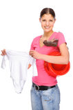Young mother. Full isolated studio picture from a young girl with baby clothes royalty free stock photography