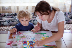 Young mother and 2 years old son drawing Stock Photography