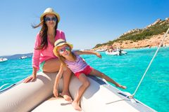 Young mother with adorable daughter enjoy vacation Stock Photos