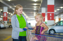 Young mother and adorable daughter in shopping cart on undergrou Stock Photography