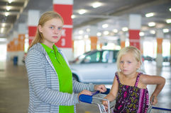 Young mother and adorable daughter in shopping cart on undergrou Royalty Free Stock Image