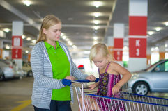 Young mother and adorable daughter in shopping cart on undergrou Royalty Free Stock Images