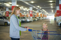 Young mother and adorable daughter in shopping cart on undergrou Royalty Free Stock Photography