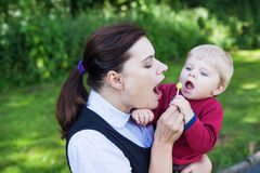 Young mother and adorable toddler having fun in summer Stock Image