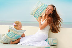 Young Mother And Her Daughter Have A Fun Outdoor Stock Photo
