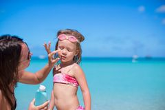 Young mother applying sunblock cream on her Royalty Free Stock Photography