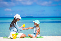 Young mother applying sunscreen on her kid royalty free stock photo