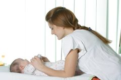 Young mother with baby Stock Photo