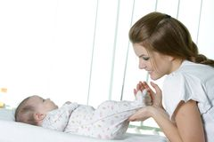 Young mother with baby Stock Image