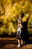 Young mother and baby boy in autumn park stock images