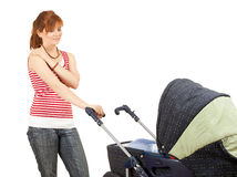 Young mother and baby  buggy Stock Photography