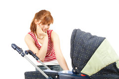 Young mother and baby buggy Stock Photo