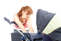 Young mother and baby buggy Royalty Free Stock Image