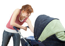 Young mother and baby cart Royalty Free Stock Photos