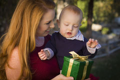 Young Mother and Baby with Christmas Gift Royalty Free Stock Image