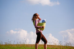 Young mother with baby in a field Royalty Free Stock Image
