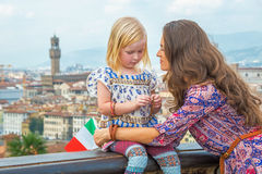 Young mother and baby girl against panoramic view of florence, italy Stock Photography