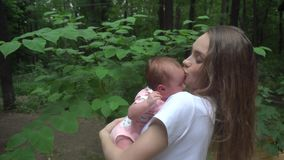 Young mom with baby in her arms stock footage