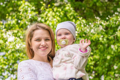 A young mother with a baby in her arms Royalty Free Stock Image