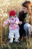 Young mother with baby in a meadow. Young mother with her little baby in a meadow Royalty Free Stock Photo