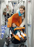 Young mother with baby  at metro. Young mother with baby in stroller at metro Royalty Free Stock Photos