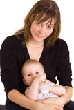 Young mother, baby and milk bottle Stock Image