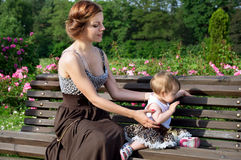 Young mother with a baby in nature Stock Photo
