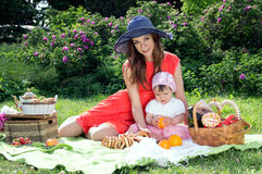 Young mother with a baby in nature Royalty Free Stock Photo