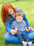 Young mother with baby at the park Stock Image