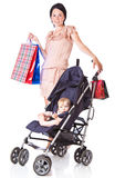 Young mother with baby in perambulator Royalty Free Stock Image