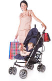 Young mother with baby in perambulator Royalty Free Stock Photography
